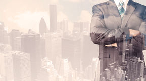 Handsome business man with overlay cityscape Royalty Free Stock Photography