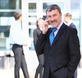 A handsome business man on phone Royalty Free Stock Image