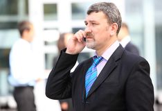 A handsome business man on phone Royalty Free Stock Photography