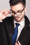 Handsome business man putting on his glasses Royalty Free Stock Image
