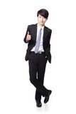 Handsome business man show thumb up. Young handsome business man show thumb up in full length isolated on white background, asian model Royalty Free Stock Photography