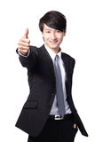 Handsome business man show thumb up Stock Photos