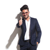Handsome business man showing thumbs up Royalty Free Stock Photo