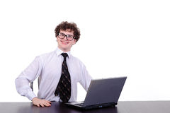 A handsome business man sitting at table Stock Images