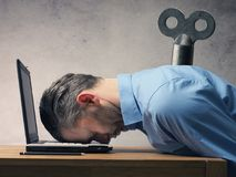 Business man sleeping on laptop Royalty Free Stock Images