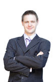 Handsome business man smiling. A man in business suit posing for the camera Stock Photography