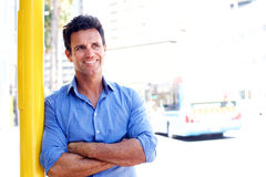 Handsome business man smiling outside in the city Stock Photo