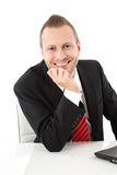Handsome business man. Handsome smiling young business man in office, isolated on white Stock Images