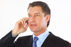 Handsome business man speaking. On the mobile Royalty Free Stock Image
