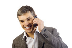 Handsome business man speaking on a mobile Stock Image