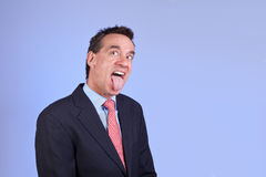 Handsome Business Man Sticking out Tongue Royalty Free Stock Image