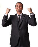 Handsome business man success. Handsome business man holding his fist and smiling because success Royalty Free Stock Images