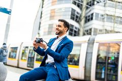 Handsome business man on suit outdoors royalty free stock images