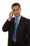 Handsome business man talking on the phone Stock Photography