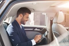 Handsome business man test drive new car royalty free stock image