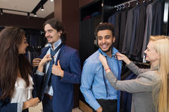Handsome Business Man Trying Clothes Woman Fashion Shop, Customers Choosing In Retail Store. Handsome Business Man Trying Suit Clothes Woman Assistant Help Stock Photos