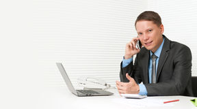 Handsome business man using cell phone Royalty Free Stock Images