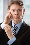 Handsome business man using cell phone Stock Photos