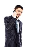 Handsome business man using cell phone, smiling Stock Photos