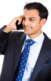 Handsome business man using cell phone, smiling Royalty Free Stock Photo