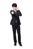 Handsome business man using mobile phone. Portrait of handsome young business man using cell phone, pointing to you, isolated on gray background, asian model Stock Photo