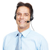Handsome business man wearing headset and smiling Royalty Free Stock Photo