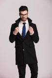 Handsome business man wearing a long black coat Stock Image