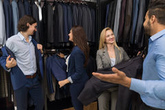 Handsome Business Man And Woman Fashion Shop, Customers Choosing Clothes In Retail Store. Young People Shopping Formal Wear Royalty Free Stock Photo