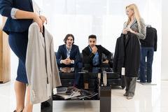 Handsome Business Man And Woman Fashion Shop, Customers Choosing Clothes In Retail Store. Young People Shopping Formal Wear Royalty Free Stock Photos