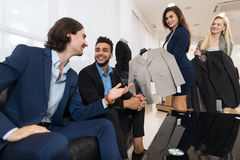 Handsome Business Man And Woman Fashion Shop, Customers Choosing Clothes In Retail Store. Young People Shopping Formal Wear royalty free stock image