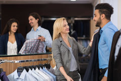 Handsome Business Man And Woman Fashion Shop, Customers Choosing Clothes In Retail Store. Young People Shopping Formal Wear Royalty Free Stock Images