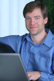 Handsome business man working on laptop Royalty Free Stock Photography