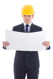 Handsome business man in yellow builder's helmet with blueprint Stock Photography
