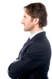 Handsome business professional, side pose Royalty Free Stock Image