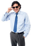Handsome businessman adjusting sunglasses. Happy smart male professional adjusting his goggles Royalty Free Stock Photography