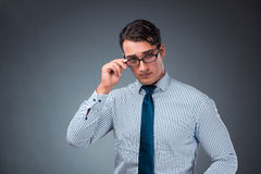 The handsome businessman against gray background Stock Photo