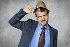 Handsome businessman assumes hat party animal Royalty Free Stock Image