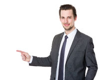 Handsome businessman or attorney or politician pointing aside Stock Photography