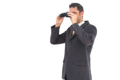 Handsome businessman with binoculars Stock Image