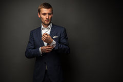 Handsome businessman on black royalty free stock photography