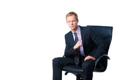 Handsome businessman in black office chair Royalty Free Stock Photo