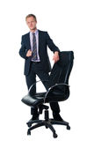 Handsome businessman with black office chair Stock Photography