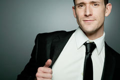 Handsome businessman in black suit. Royalty Free Stock Photos