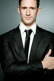 Handsome businessman in black suit. Stock Photography