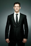 Handsome businessman in black suit. Stock Image