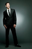 Handsome businessman in black suit. Royalty Free Stock Image