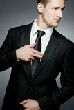 Handsome businessman in black suit. Stock Image