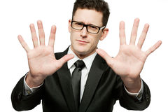 Handsome businessman in black suit making Royalty Free Stock Image
