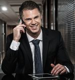 Handsome businessman in black suit Royalty Free Stock Images