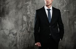 Handsome businessman in black suit Stock Photo